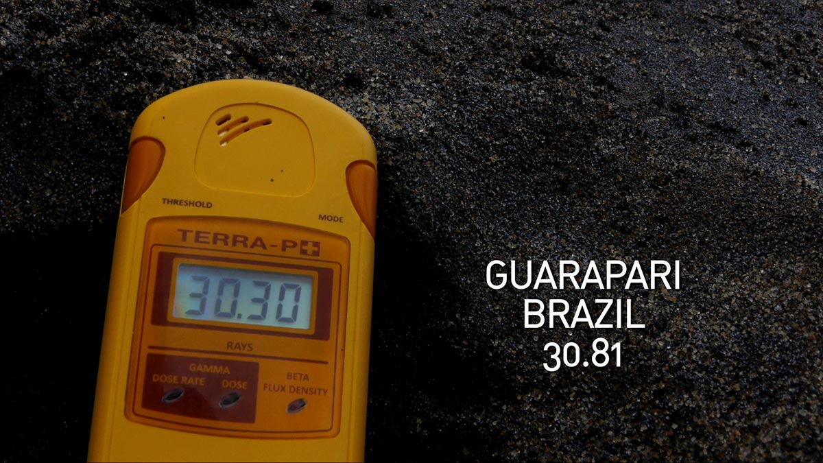 A geiger counter records the radiation level in Guarapari Beach, Brazil in a scene from PANDORA'S PROMISE.  Photo: Robert Stone